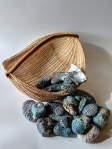 Egg Basket displaying stitched stones 2016-2018, waxed linen, stones